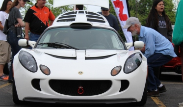 My favorite car (the Lotus). I love how its smile mirrors the smile on the gentlman's face. Rise & Drive 5.17.15